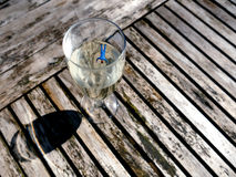 Miniature workmen floating head down in champagne glass Royalty Free Stock Photos