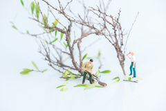 Miniature workmen working in felling and cutting trees close up Royalty Free Stock Photography