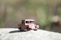 Miniature, the world of the might small. My brother in law owns this vintage toy, a truck. The old trucks, but the idea here is how strong the toys of the old Royalty Free Stock Photo
