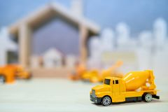 Miniature yellow concrete mixer truck model royalty free stock images