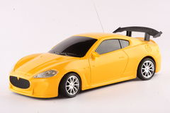 A miniature of yellow sports car. On white background Stock Images