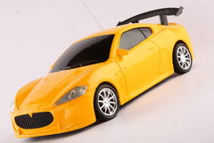 A miniature yellow toy  sports car Stock Photo