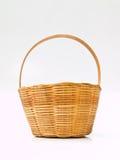 A miniature yellow wicker basket isolated on white Stock Photos