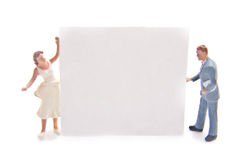 Miniatures with blank sign. Miniature figures with a blank sign Royalty Free Stock Photo