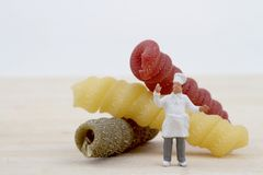 Miniatures of chef with pasta Stock Image