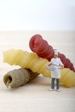 Miniatures of chef with pasta Royalty Free Stock Photo