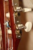 Miniatures of climbers on a classic guitar Stock Photos