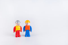Miniatures of construction workers Royalty Free Stock Photo