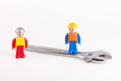 Miniatures of construction workers Royalty Free Stock Photos