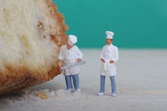 Miniatures of cooks with bread Stock Image