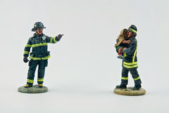 Miniatures of firefighters royalty free stock image