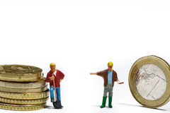 Miniatures with money Stock Photo