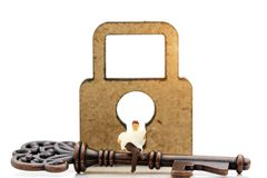 Miniatures people read the book to find out how to unlock the key, Education or business concept. stock image