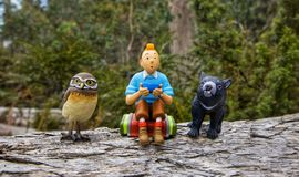Miniatures of Tintin, Owl and Tasmanian devil stock photo