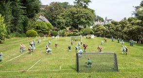 Miniaturfußballspiel Stockfoto