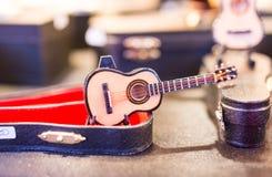 Miniaturgitarre Abschluss- oben stockfotografie