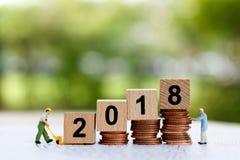 Miniaturleute bewegen Block Nr. 2018 Stockbilder