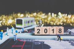 Miniaturleutearbeitskraftgestaltholzklotz Nr. 2018 Stockbild