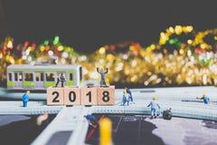Miniaturleutearbeitskraftgestaltholzklotz Nr. 2018 Lizenzfreie Stockfotos