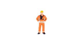 Miniaturowi ludzie w inżyniera i pracownika zajęciu Obraz Royalty Free