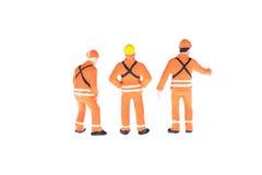Miniaturowi ludzie w inżyniera i pracownika zajęciu Zdjęcie Stock