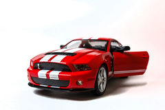 Miniaturowy czerwony samochód Fotografia Royalty Free