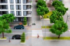 Miniaturowy model, miniatura zabawkarscy budynki, samochody i ludzie, Miasta maquette Zdjęcie Stock