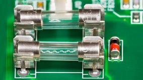 Miniaturowy szklany elektryczny lontu szczegół z falistym topliwym drutem obraz royalty free