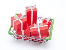 Miniaturowy zakupy kosz z sześć czerwonymi prezentów pudełkami obrazy royalty free