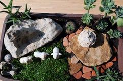 Miniaturtopfgarten stockbilder