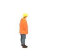 Miniatuur de arbeidersbouw van de menseningenieur op witte backgroun Stock Afbeeldingen