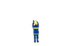 Miniatuur de arbeidersbouw van de menseningenieur op witte backgroun Royalty-vrije Stock Afbeelding