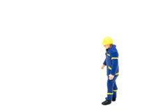 Miniatuur de arbeidersbouw van de menseningenieur op witte backgroun Royalty-vrije Stock Foto's