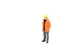 Miniatuur de arbeidersbouw van de menseningenieur op witte backgroun Royalty-vrije Stock Foto