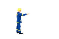 Miniatuur de arbeidersbouw van de menseningenieur op witte backgroun Royalty-vrije Stock Fotografie