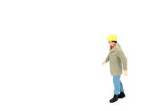 Miniatuur de arbeidersbouw van de menseningenieur op witte backgroun Stock Afbeelding