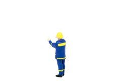 Miniatuur de arbeidersbouw van de menseningenieur op witte backgroun Stock Foto