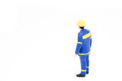 Miniatuur de bouwconcept van de mensenarbeider op witte achtergrond Royalty-vrije Stock Fotografie