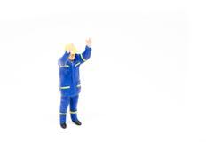 Miniatuur de bouwconcept van de mensenarbeider op witte achtergrond Stock Afbeelding