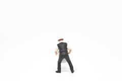 Miniatuur de mensenconcept van de mensenlevering op witte achtergrond met a Stock Afbeeldingen