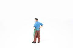 Miniatuur de mensenconcept van de mensenlevering op witte achtergrond met a Stock Foto