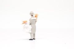 Miniatuur het paarreiziger van het mensenhuwelijk op achtergrond met spac Stock Fotografie