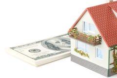 Miniatuurhuis en Geld. royalty-vrije stock afbeeldingen