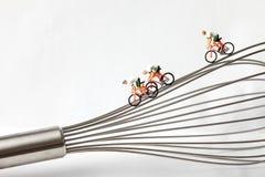 Miniatyrcyklist på en vifta Royaltyfri Bild