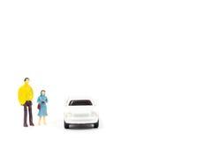 Miniatyrdiagram av folk och bilen Royaltyfria Bilder