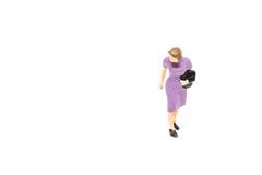 Miniatyrfolk som går passagerarebegrepp på bakgrund med a fotografering för bildbyråer