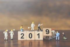 Miniatyrträkvarter nummer 2019 för arbetarlagbyggnad arkivfoton
