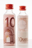 Minibar bottle and euro money. Royalty Free Stock Photography