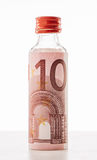Minibar bottle and euro money. Stock Photography