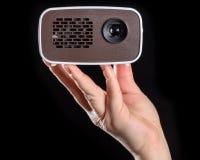 Minibeamer ha tenuto nella mano Fotografia Stock